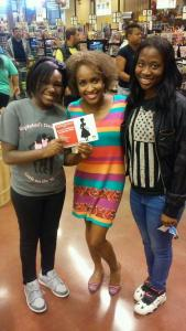 Author and motivational speaker Valorie Burton taking a moment to speak with members of Zelophehad's Daughters about their anti-trafficking rally.