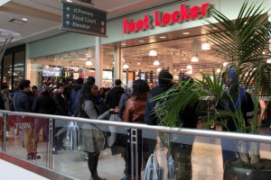 Michael Jordan sneakers fans are waiting in front of the Foot Locker store to buy their favorite sneaker in Queens Mall on Saturday,December 21,2013.