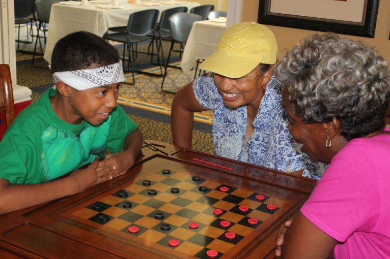 Playing checkers at a local senior center